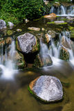 Mountain creek with waterfall Stock Image