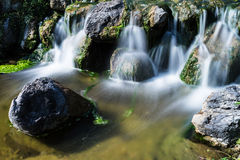 Mountain creek with waterfall Royalty Free Stock Image