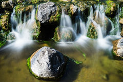 Mountain creek with waterfall Stock Photography