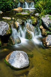 Mountain creek with waterfall Royalty Free Stock Images