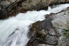 Mountain creek and waterfalls stock image