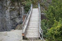 Mountain creek wood bridge view Royalty Free Stock Images