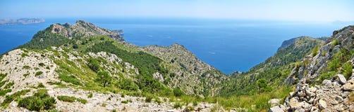 Mountain crest and ocean panorama Stock Photos