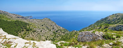 Mountain crest and ocean panorama Royalty Free Stock Photo