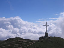Mountain Cross. This cross is located in the top of the montain Caraiman (Busteni, Romania)where the clouds are anear stock images
