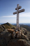 Mountain cross with bit mountains in the Stock Images