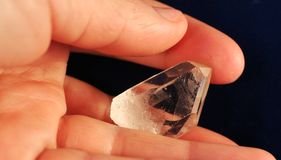 Mountain crystal in hand Stock Photos