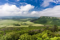 Mountain cuesta, green field Royalty Free Stock Photos