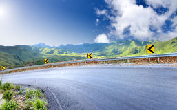Mountain curve road and traffics sign Royalty Free Stock Image
