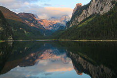 Mountain Dachstein,and Gossausee lake on sunset. Stock Image