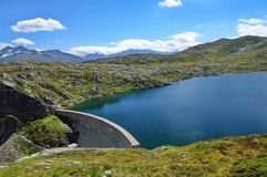 Mountain dam. Summer landscape in Alps Mountains Stock Images