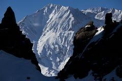 Mountain between dark rocks. View of Cerro Yeserasduring winter season. Based close Las leñas ski resort, is a 4000 meters peak. One of the thousand peaks alone Royalty Free Stock Photos