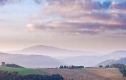 Mountain dawn with farmhouse Stock Photos