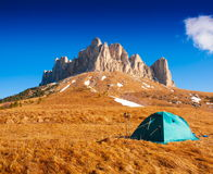 Mountain day autumn. Tent. Unique stock photos