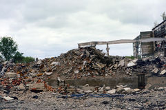 The mountain of debris. Destroyed the factory building and the road as after shelling. The mountain of debris Stock Image