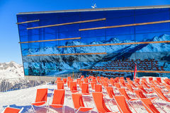 Mountain deckchairs. Deckchairs and mountains reflected on the restaurant wall royalty free stock photos