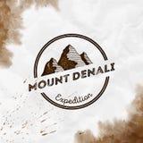 Mountain Denali logo. Round expedition sepia vector insignia. Denali in Alaska, USA outdoor adventure illustration. Climbing, trekking, hiking, mountaineering vector illustration
