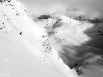 Mountain Descent. An unidentifiable man descends a steep mountain on skis in Haines, Alaska Royalty Free Stock Photo