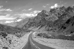 Mountain landscape with empty road in monochrome royalty free stock photo