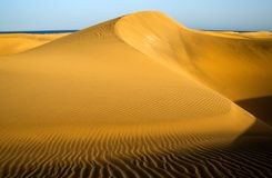 Mountain in the desert of Maspalomas Stock Photos