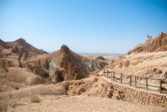 Mountain desert with a path fenced with a simple wooden fence of royalty free stock image