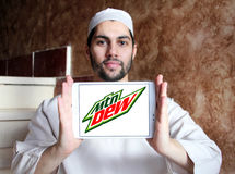 Mountain dew logo. Logo of drinks company mountain dew on samsung tablet holded by arab muslim man royalty free stock photography