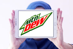 Mountain dew logo. Logo of drinks company mountain dew on samsung tablet holded by arab muslim woman stock photo
