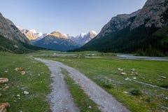 Mountain dirt road in Djuku ravine. Kirghizia Royalty Free Stock Image