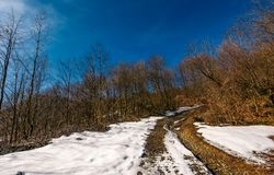 Mountain dirt road in winter. Beautiful sunny day Stock Images