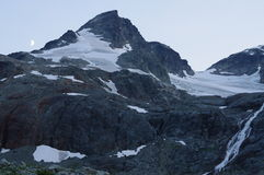 Mountain at dusk with half moon royalty free stock photography