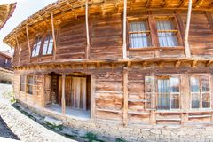 Wooden hotel in Bulgarian Zheravna. Mountain eco-village Zheravna - Bulgarian national carpet center, rural tourism, national rural architecture and a popular royalty free stock image