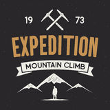 Mountain expedition label with climbing symbols and type design - mountain climb. Vector isolated on dark. Mountain expedition label with climbing symbols and Royalty Free Stock Photo