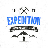 Mountain expedition label with climbing symbols and type design - mountain climb. Vintage letterpress style style. Outdoors adventure emblem for t-shirt Stock Photos