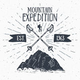 Mountain expedition vintage label retro badge. Hand drawn textured emblem outdoor hiking adventure and mountains exploring, Extrem Stock Photos