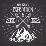 Mountain expedition vintage label retro badge. Hand drawn textured emblem outdoor hiking adventure and mountains exploring, Extrem Royalty Free Stock Photography