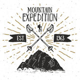 Mountain expedition vintage label retro badge. Hand drawn textured emblem outdoor hiking adventure and mountains exploring, Extrem Royalty Free Stock Photos