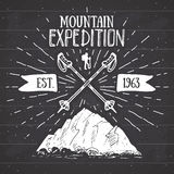 Mountain expedition vintage label retro badge. Hand drawn textured emblem outdoor hiking adventure and mountains exploring, Extrem Royalty Free Stock Images