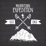 Mountain expedition vintage label retro badge. Hand drawn textured emblem outdoor hiking adventure and mountains exploring, Extrem Royalty Free Stock Photo