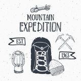 Mountain expedition vintage set. Hand drawn sketch elements for retro badge emblem, outdoor hiking adventure and mountains explori Stock Photos