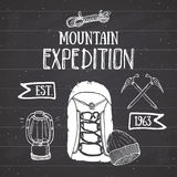 Mountain expedition vintage set. Hand drawn sketch elements for retro badge emblem, outdoor hiking adventure and mountains  Royalty Free Stock Images