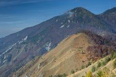 Mountain in fall colors. Kamniški vrh, Gorenjska, Slovenia. Krvavec in the background Royalty Free Stock Images