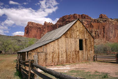 Mountain Farm. Barn and barn yard in a mountain valley with blue sky and clouds at Capitol Reef National Park Utah Royalty Free Stock Images