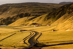 Mountain farm. Mountain landscape with farm house in southern Iceland Stock Images
