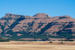 Mountain Farming Fields Prairie Winter. Winter farming prairies landscape in the Maluti mountains. Dry fields and large mountain vegetation backdrop into the Royalty Free Stock Photos