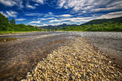 Mountain fast flowing river stream of water Royalty Free Stock Images