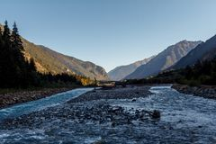 Mountain fast River amidst the big mountains. Mountain River amidst the mountains royalty free stock photos