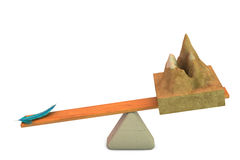 A mountain with a feather  on the seesaw,3D illustration. Stock Photography