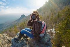 Mountain female photographer Stock Images