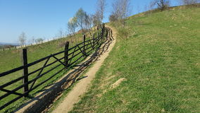 Mountain fence. Mountain rural road Royalty Free Stock Photography