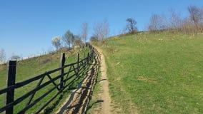 Mountain fence. Mountain rural road Stock Photo
